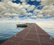 Wooden pier. Going into the ocean Stock Photography