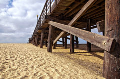 Wooden Pier. A view of an old wooden pier from the beach Royalty Free Stock Photos