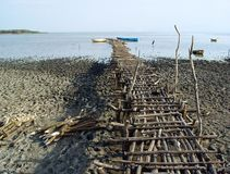 Wooden pier. As walkway to reach the boats moored on the shore of Lake Chamo in Ethiopia Stock Photos