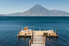 Wooden pier on Atitlan lake Royalty Free Stock Photo