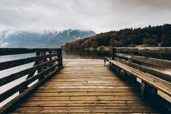 Wooden pier at autumn lake, fall colors. royalty free stock images