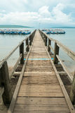 Wooden pier with Balinese boats near Taman Barrat National Park, Royalty Free Stock Photography