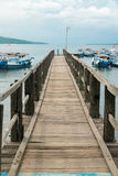 Wooden pier with Balinese boats near Taman Barrat National Park, Royalty Free Stock Photos
