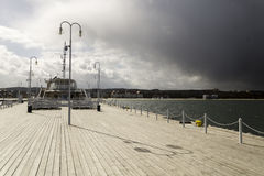 Wooden pier on the Baltic coast during a storm. Sopot, Poland royalty free stock photos
