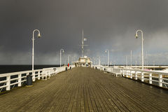 Wooden pier on the Baltic coast during a storm. Sopot, Poland stock photography