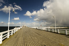 Wooden pier on the Baltic coast during a storm. Sopot, Poland royalty free stock photo