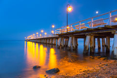 Wooden pier on Baltic Sea at night Stock Images