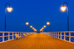 Wooden pier on Baltic Sea at night Stock Photo