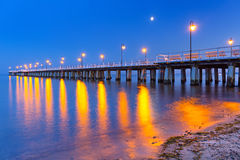 Wooden pier on Baltic Sea at night Stock Image