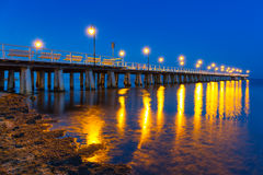 Wooden pier on Baltic Sea at night Stock Photos