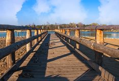 Wooden pier on the beach. royalty free stock images