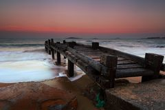Wooden pier on the beach stock photography