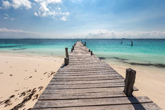 Wooden pier on  beach Royalty Free Stock Image