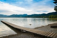 Wooden pier in the beach of Tegernsee lake in Germany royalty free stock image