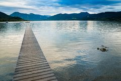 Wooden pier in the beach of Tegernsee lake in Germany royalty free stock photo