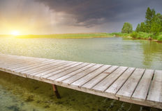 Wooden pier on beautiful lake. Royalty Free Stock Image