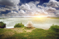 Wooden pier on beautiful lake. Nature composition Royalty Free Stock Photography