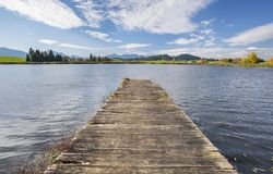 Wooden pier in beautiful lake at alps mountains. In Bavaria, Germany Stock Image
