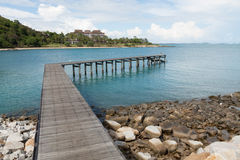 Wooden pier in blue sea Stock Photos