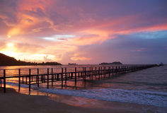 Wooden pier and beautiful sky at the sunrise Stock Images
