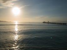 Wooden pier, beautiful sunrise, Majorca island Muro beach Stock Image