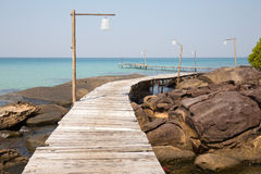 Wooden pier on the beautiful tropical beach Stock Image