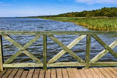 Wooden pier on big lake Lebsko in Poland. Royalty Free Stock Photos