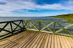 Wooden pier on big lake Lebsko in Poland. Stock Photography