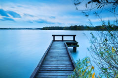 Wooden pier on big lake with long exposure Stock Image