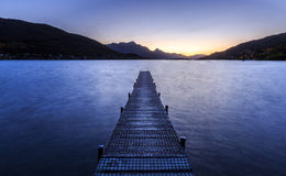 Wooden pier on big lake in Queenstown Royalty Free Stock Photography