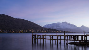 Wooden pier on big lake in Queenstown, New Zealand Royalty Free Stock Photo