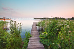 Wooden pier on big lake in summer Royalty Free Stock Photo