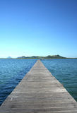 Wooden pier on blue lagoon Stock Photography