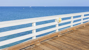 Wooden pier with blue ocean and sky. Royalty Free Stock Photography