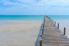 Wooden pier with blue sea and sky background Royalty Free Stock Images