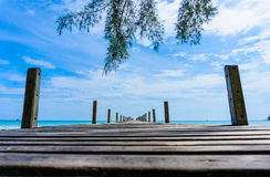 Wooden pier with blue sea and sky background Royalty Free Stock Image