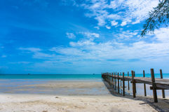 Wooden pier with blue sea and blue sky background Royalty Free Stock Photos