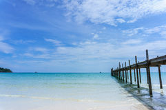 Wooden pier with blue sea and sky background Royalty Free Stock Photo
