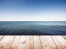 Wooden pier on blue sea Royalty Free Stock Photo