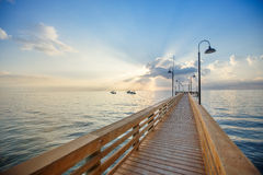 Wooden pier and boardwalk over ocean Royalty Free Stock Photo