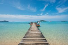 Wooden pier with boat in Phuket, Thailand. Summer, Travel, Vacat Royalty Free Stock Image
