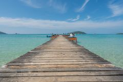 Wooden pier with boat in Phuket, Thailand. Summer, Travel, Vacat Stock Image