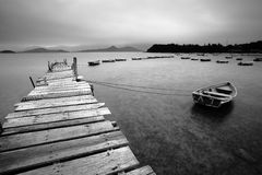 Wooden pier and boats Stock Images