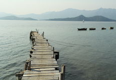 Wooden pier with boats Royalty Free Stock Images