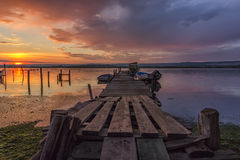 Wooden pier and boats Stock Image