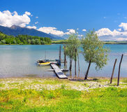 Wooden pier and boats at the Liptovska Mara lake Stock Photo