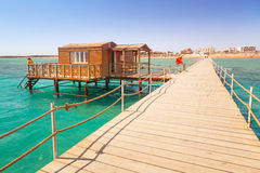 Wooden pier with change room house on Red Sea Royalty Free Stock Images