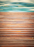 Wooden pier and clear water Stock Photos