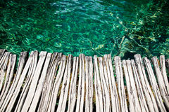 Wooden pier and clear water Stock Photo
