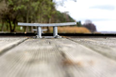 Wooden pier with cleat Stock Photo